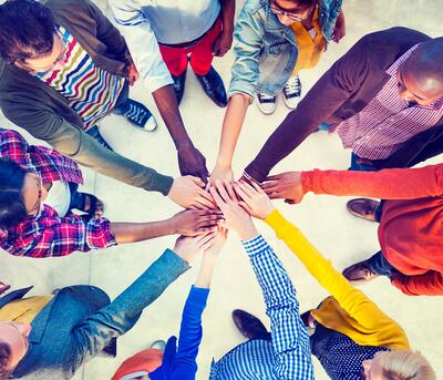 Photo of community holding hands - iStock-525109731 HOMY - community hands